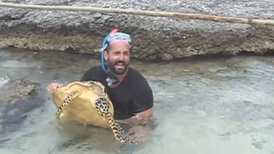 What this turtle does to this man will make you laugh. LOL!